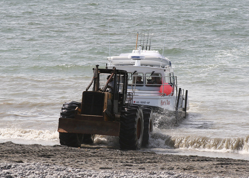 Bringing in boat at beach in Ninilchik, AK