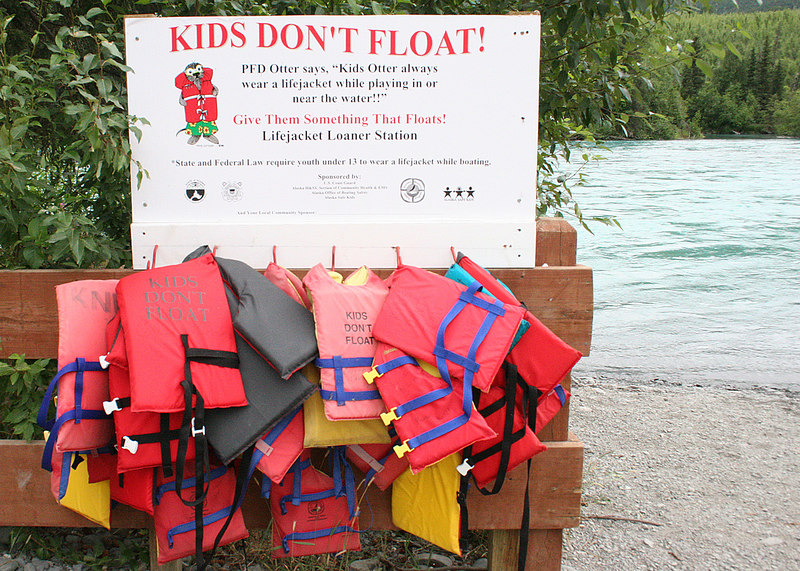"Alaska has a program ""Kids Don't Float"" and at all state boat launches you will see a sign like this and life jackets"