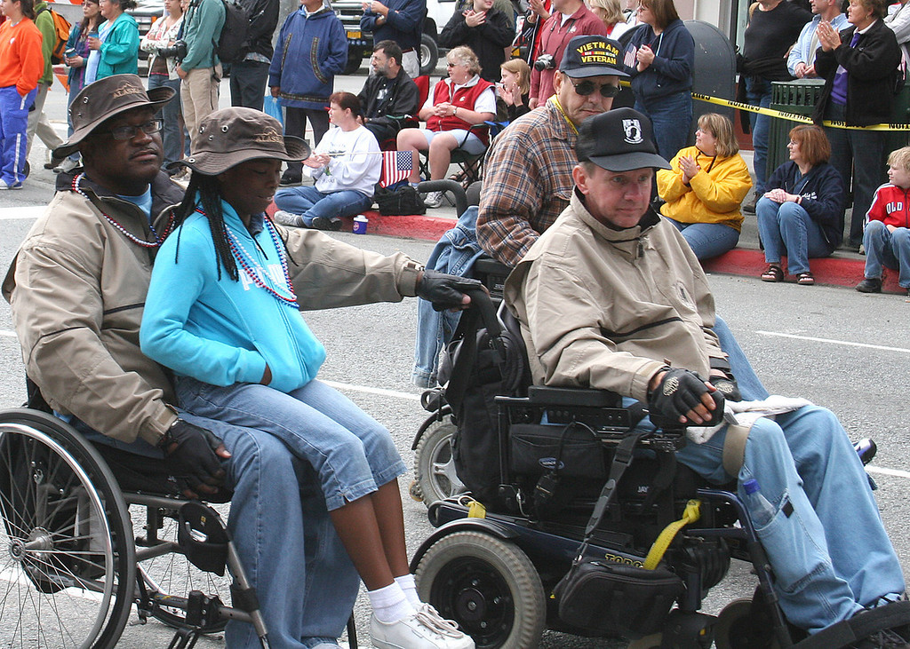 Veterans helped each other and even took their families with them in the parade