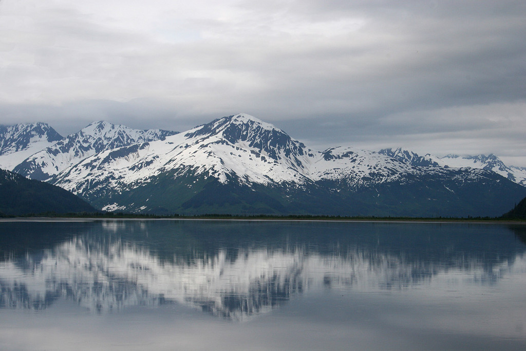 Snow clad mountains reflected in the water of Turnagain Arm