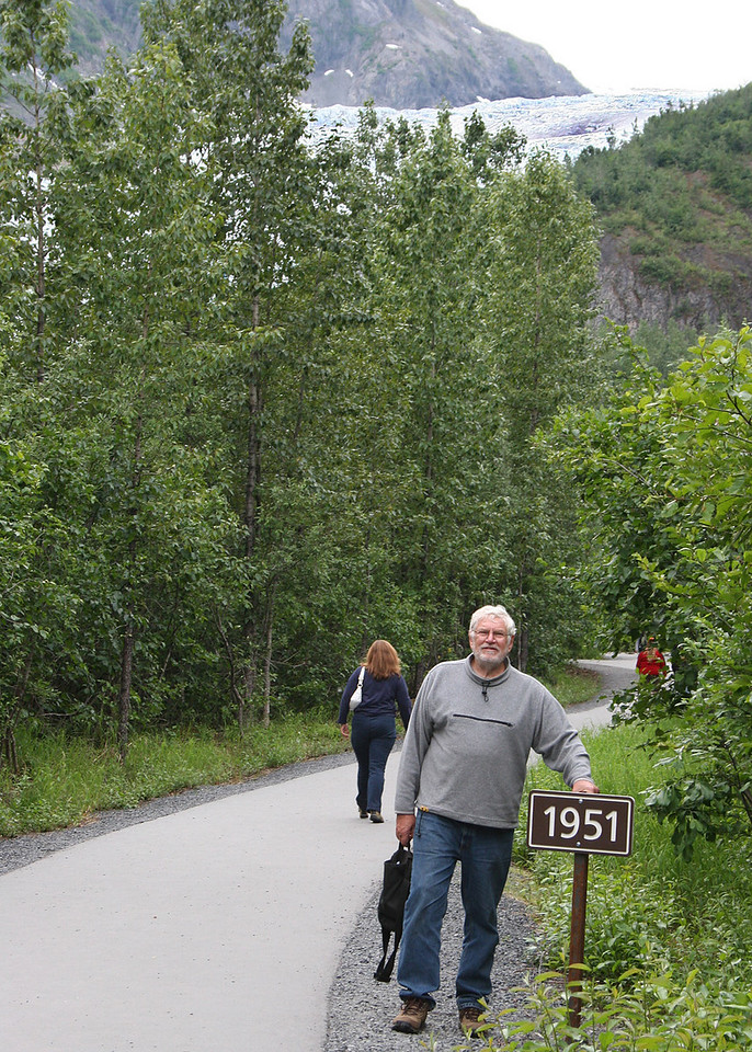 Mike at a sign showing where Exit Glacier was in 1951.  You can see the glacier in the back.