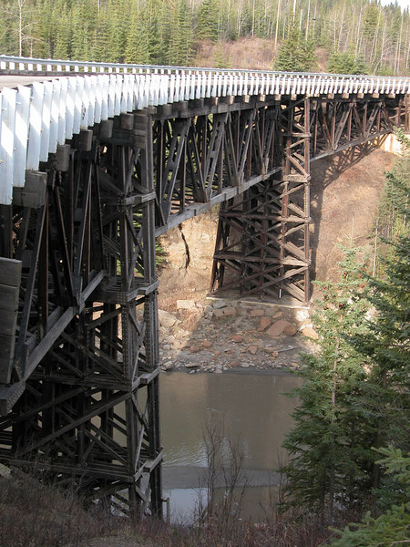 5/11/06 - The Kiskatinaw Bridge is 531 feet long and is the only original timber bridge built along the Alaska Highway that is still in use today.  It is a beautiful structure both in the fact it is made of wood and because of its curved design.