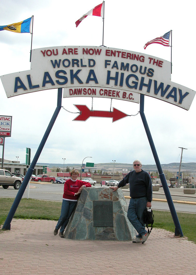 5/10/06 - Mike and Susan at the Alaska Highway Mile 0 carin.  Dawson Creek is the official starting of the Alaska Highway.