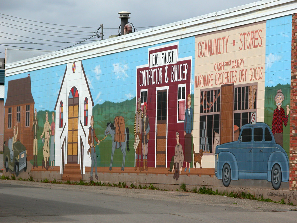 "5/11/06 - There are many murals on the Dawson Creek buildings. This one depicts the ""The Community Sores"""