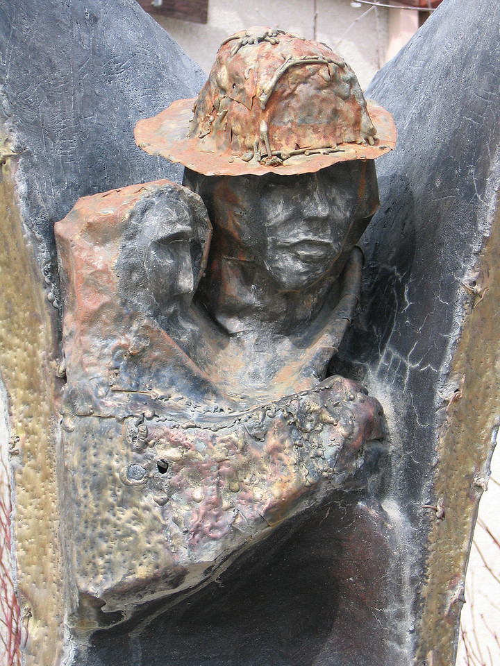 5/16/06 - Closeup of the bronze sculpture in front of the fire department