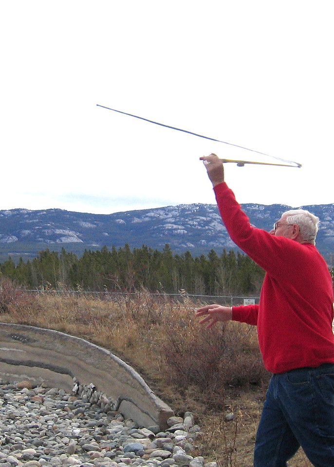 5/18/05 - Yukon Beringia Interpretive Centre; Mike using atlatl, object called an atlatl which acts as an arm extension and flings the spear.  !