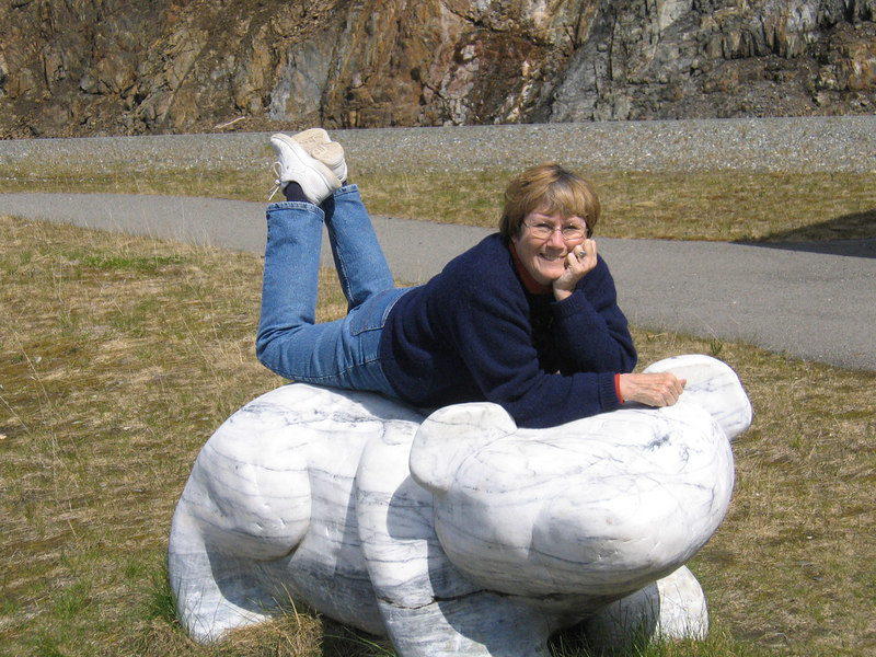 Susan on stone bear about 20 miles east of Haines