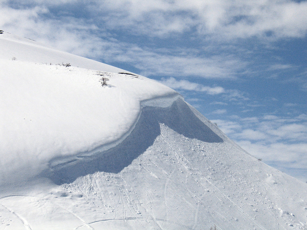 Snow drift on mountain about about 80 miles west of Haines Junctiont