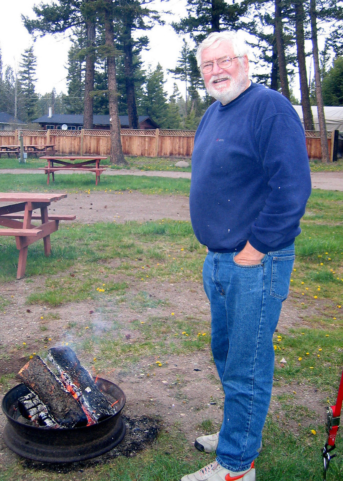 Mike keeping warm by the fire.  Look closely on his blue shirt and you can see the snow!