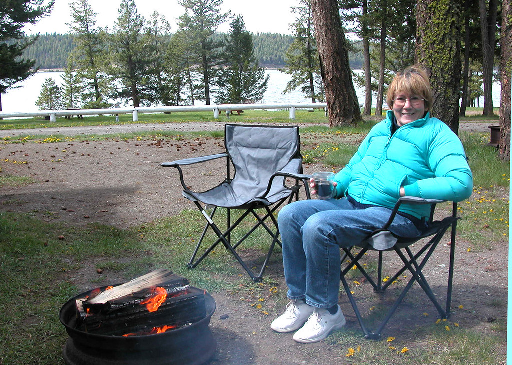 Susan enjoying the fire with the lake in the background.  This was mid-day and it was cold.