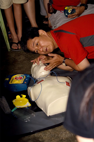 Steven performing a CPR along with the defribillator.