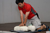 Horin performing the CPR 30 - 2 method. Observe the interlocking hands.
