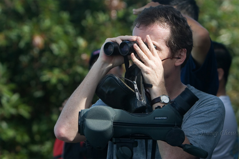 A bird watcher with his Swarovski scope.