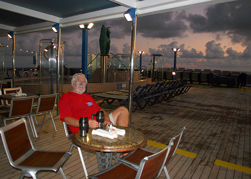 Mike enjoying a cup of coffee while enjoying the sunrise