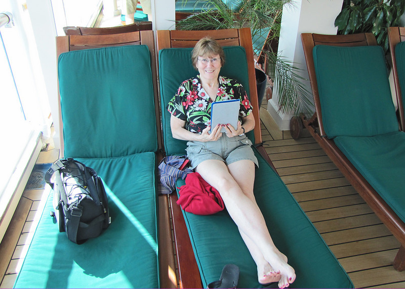 Susan reading in the adult area where we spent most of our time.  It is climate controlled and has a swimming pool and 2 hots tubs plus lots of very comfortable lounges.