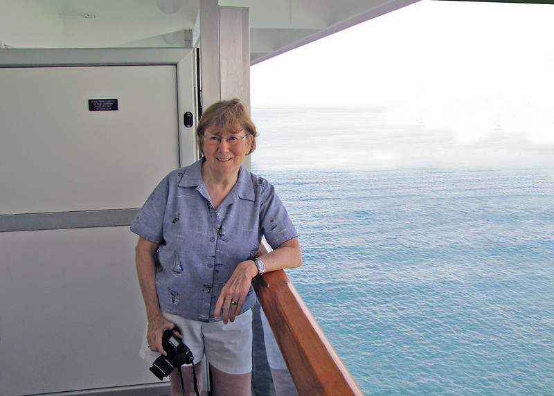 12/13/10 - Susan on balcony as we are coming into Progresso, Mexico