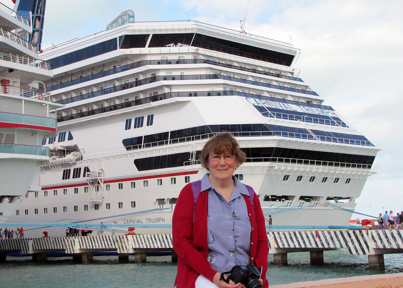 12/13/10 - Susan in front of our Carnival Cruise Ship, The Triumph, in Progresso. Mexico.