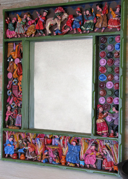 I wish you could see the detail in this mirror.  If it were smaller I would have gotten one and brought it home; I just loved it.