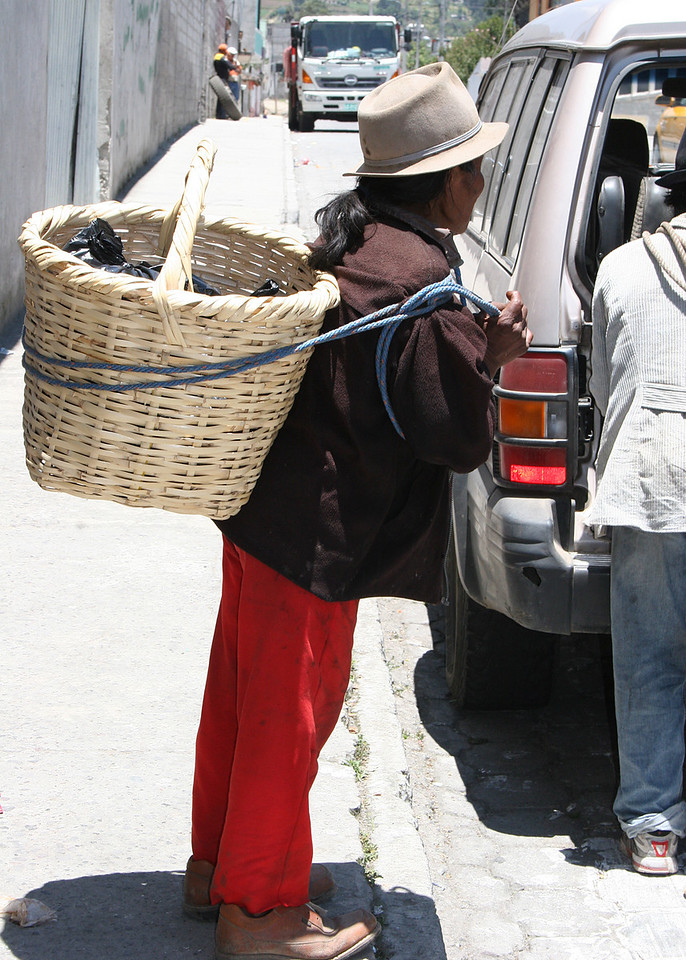 Frank hired three men, this is one of them, to carry the produce he purchased at the market back to the car.  These men are around 75-78 and this is how they make their living  Frank paid each of them $1.50 to carry the produce.  Mike and I paid each of them $.50 for them to pose for this picture.