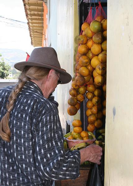 Frank buying bananas and oranges.