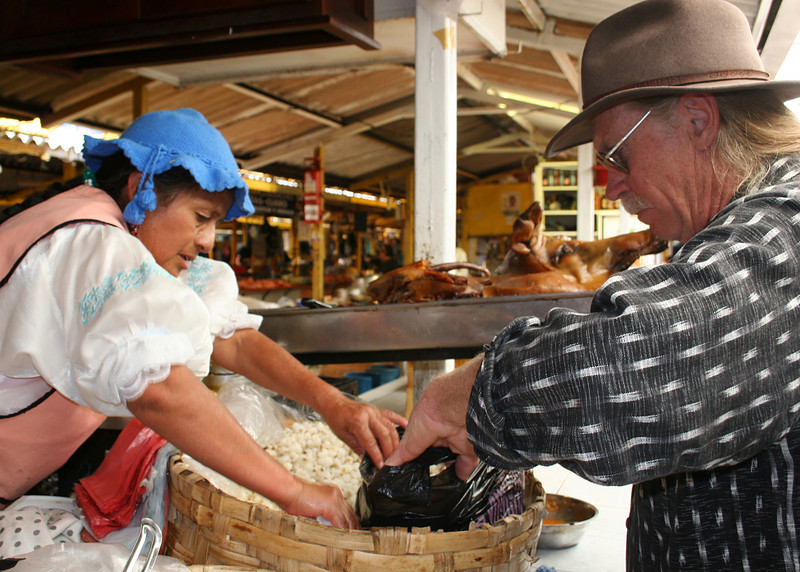 Frank buying hominy for the nights meal.