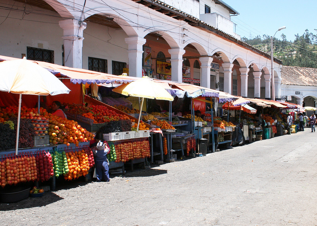 More fruit and vegetable stalls lining the street.