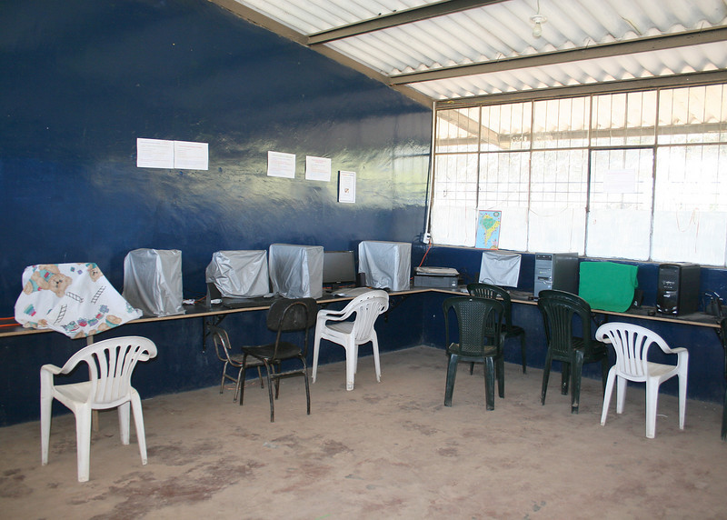 This is the computer room.  There is no internet access in the village but the students are learning the basics of the word processor and how to search using Microsoft Encarta, a digital multimedia encyclopedia published by Microsoft. <br /> <br /> Microsoft published similar encyclopedias under the Encarta trademark in various languages, including Spanish. <br /> <br /> In March 2009, Microsoft announced it was discontinuing Encarta.  It is widely attributed to competition from the much larger online encyclopedia Wikipedia.