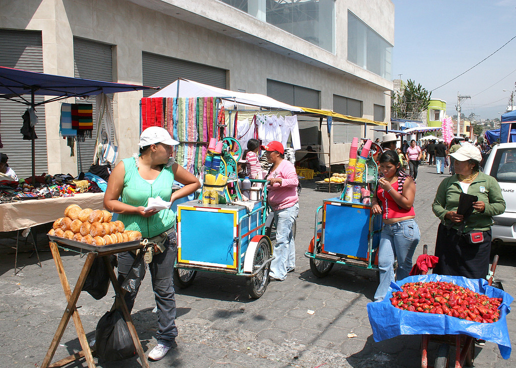 Street vendors selling various fruit and food