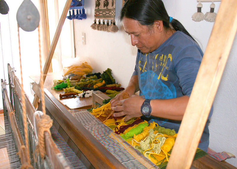 Peguche is known for its weaving.  Here is a man demonstrating his weaving techniques to us.