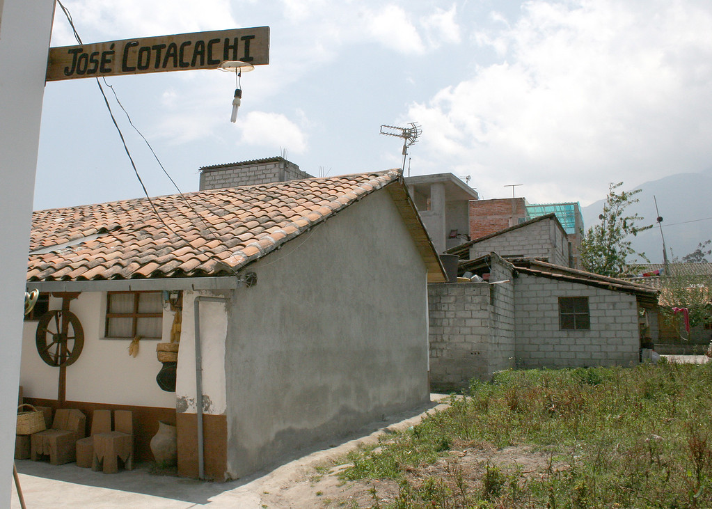 """This is a sign leading to Jose Cotacachi's showroom.  <br /> <br /> Jose Cotacachi is one of the most renowned weavers of Ecuador.  If you would like to see more of his work, here is a link:  <a href=""""http://www.josecotacachi.com"""">http://www.josecotacachi.com</a>"""
