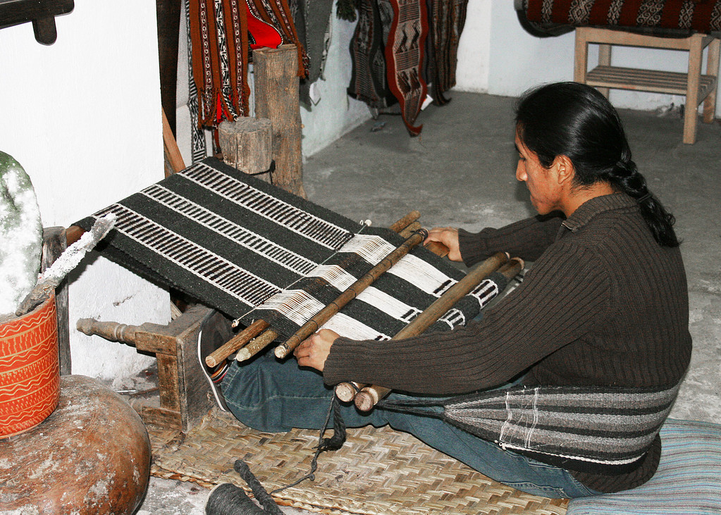 This man is using a back-strap loom.  It isn't used as much any more as it is very labor intense