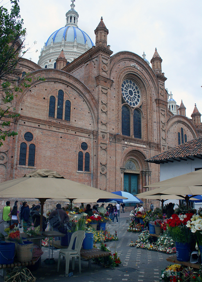 A half block west, sort of to the side of the Inmaculada Church (also known as Catedral Nueva - in the background), you'll find the Cuenca flower market, where women sell locally grown flowers from about a dozen stands. The square is directly in front of Santuario Marinano.  The entrance to La Carmen de la Asunción convent is there as well: the nuns sell religious items through a special window.