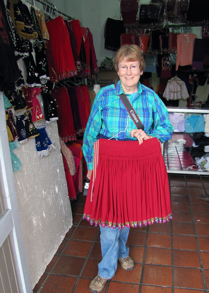 Susan showing a skirt that one of the indigenous women would wear.  They are their everyday wear, not a costume.