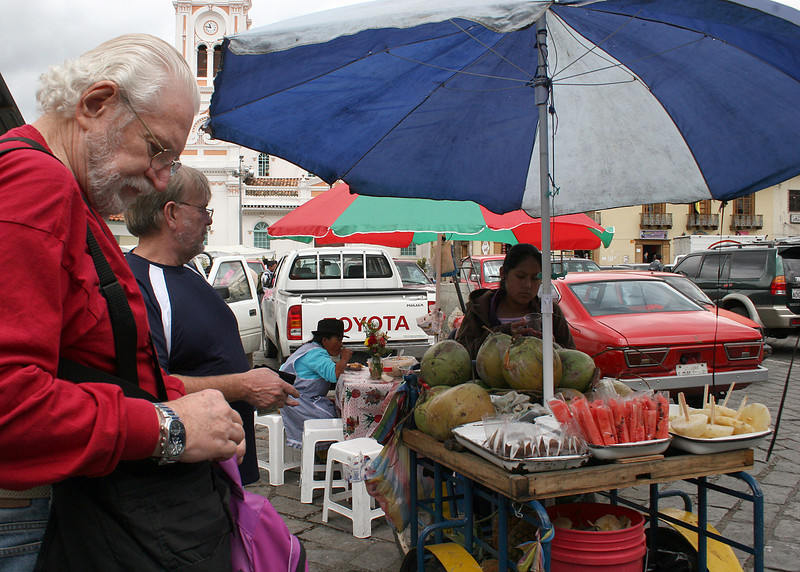 Mike and Tom purchasing fruit from vendor at indigenous market