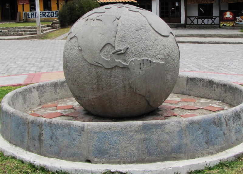 A closeup of the globe marking the equator in Cayambe.