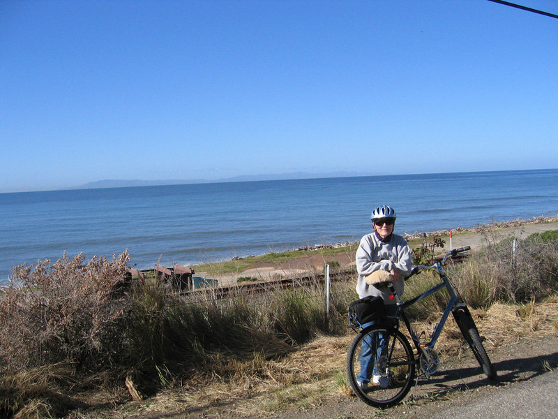 Susan biking along beach in Ventura, CA