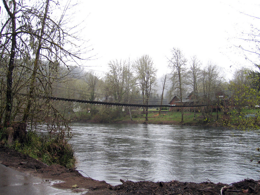 On the far side of the river from the parking lot at Hilfrich Park used to stand the Thomson's Lodge.  Still standing, but not in use, is the Thomson's Swinging Bridge which links us to the history of Helfrich Landing.  Built around 1900, its cedar planks creaked and swayed beneath the feet of guests and their luggage as they gingerly crossed to Thomson's Lodge.
