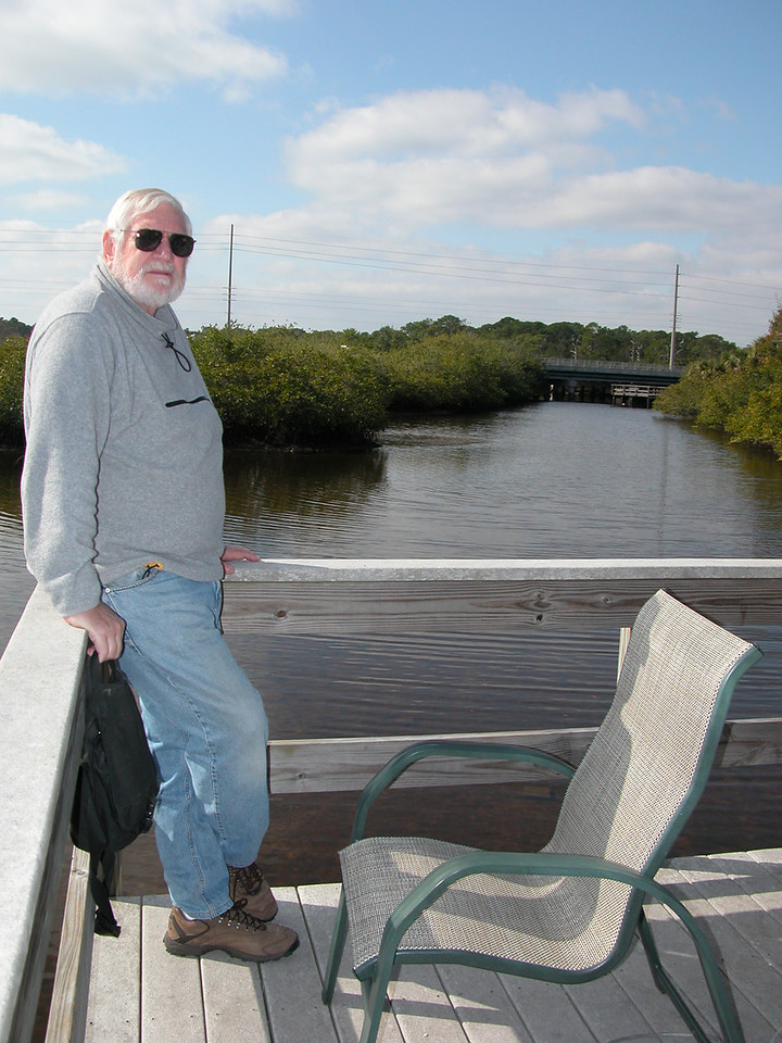 Bay Bayou RV Park - Mike on sunning deck along the canal at the back of the park.