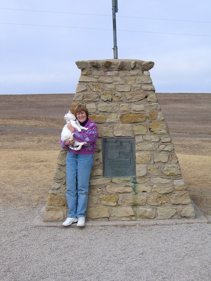 Susan and Moloko at monument at the center of the contiguous 48 in Lebanon, KS.