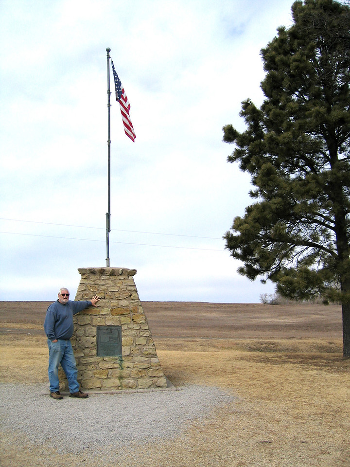 Mike at monument at the center of the contiguous 48 in Lebanon, KS.