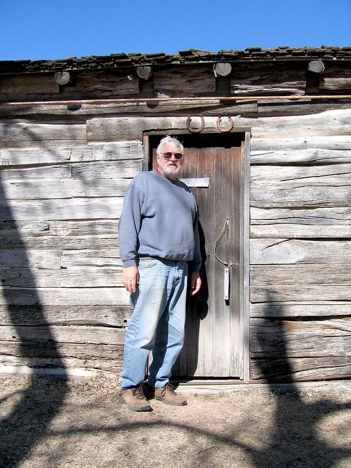 Mike in front of the door.  Notice how short the door is.  Mike had to duck to go through it.