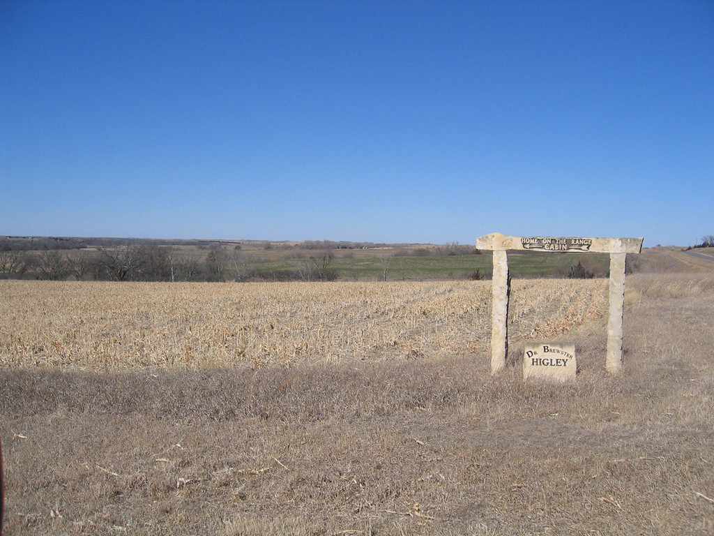 The sign showing pointing the way to the cabin as well as showing some of the surrounding countryside.