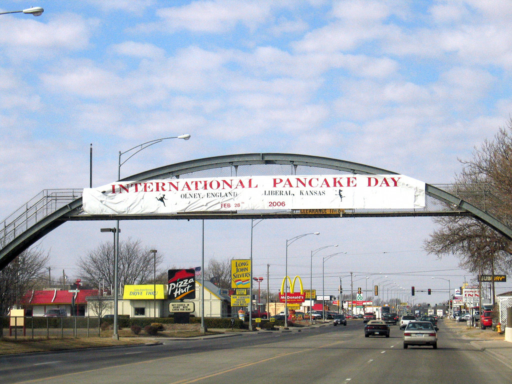 Sign about the Pancake Race as entering Liberal, KS along route 283