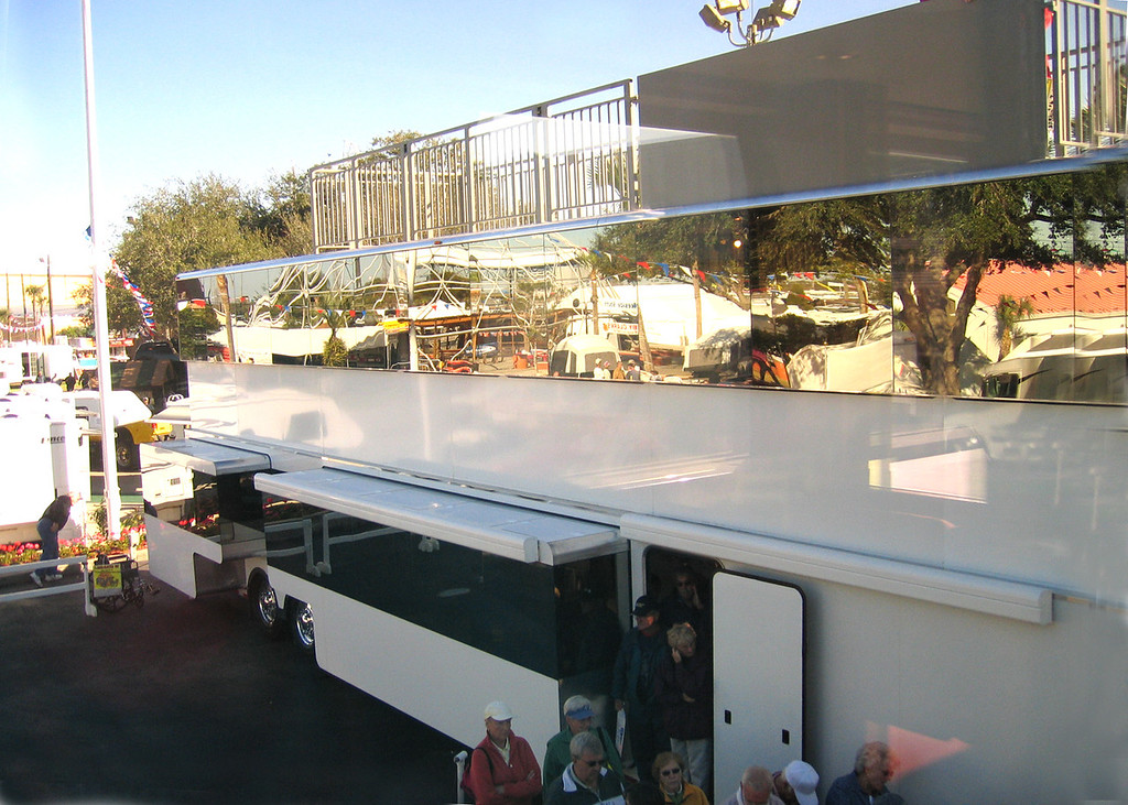 Tampa, Florida RV Show - Star Coach. This is two stories. The top shiny part closes down over the grey part when being transported.  This one even has a sun deck on top!