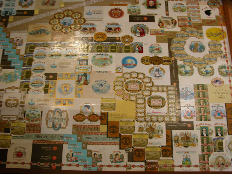 Collage of old cigar bands and pictures.