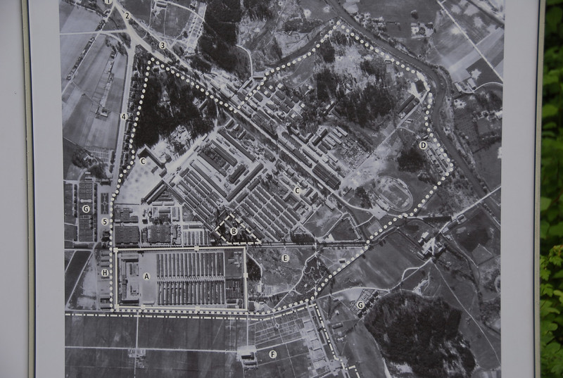 "Here's a photograph of Dachau taken during WWII. The prisoner portion was were the ""A"" is near the lower left. The majority of the site was a munitions factory. It was the first concentration camp housing primarily political and religious prisoners, and anyone who deviated from accepted standards, such as homosexuals. Founded in March of 1933, it served as the model upon which later camps were based."