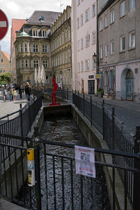 The water flows briskly through this canal in the old city of Augsburg.  Portions of this canal are covered and its open elsewhere.