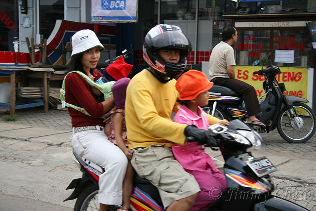 """<font color=""""yellow"""">Another common sight where many pillion riders on a single bike may be found.</font><br>"""
