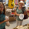 Bianca and Mariel check out the goods at   a specialty market.