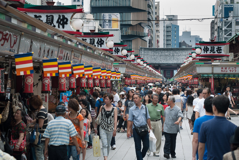 """Nakamise shopping arcade leading up to the temple starts after the Kaminarimon or """"Thunder Gate,"""" seen in the background."""